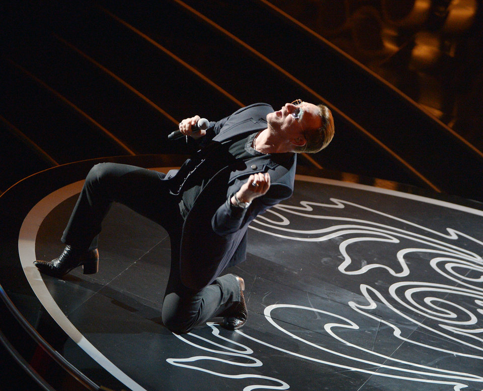 Photo - Bono of U2 performs during the Oscars at the Dolby Theatre on Sunday, March 2, 2014, in Los Angeles.  (Photo by John Shearer/Invision/AP)