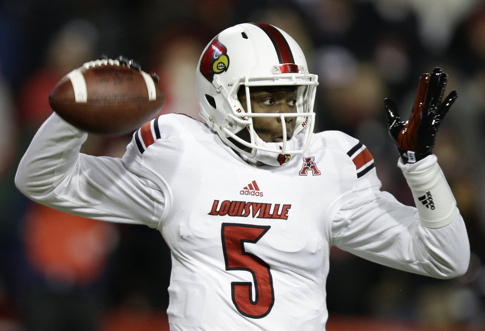 Louisville quarterback Teddy Bridgewater passes against Cincinnati in the first half of an NCAA college football game on Thursday, Dec. 5, 2013, in Cincinnati. (AP Photo/Al Behrman)