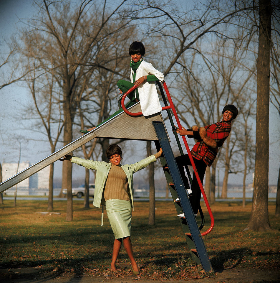 FILE - In this Aug. 19, 1966 file photo, members of the Motown singing group The Supremes are shown. Diana Ross, lead singer, is on top of the slide, Mary Wilson, hangs on the ladder, right and Florence Ballard, stands under the slide. Ross and the Supremes lived in Detroit's Brewster projects. Mayor Dave Bing has called a news conference Thursday, Nov. 15, 2012, to announce plans for the long-vacant projects, which he said in March that he wanted to demolish by year's end. (AP Photo, File)