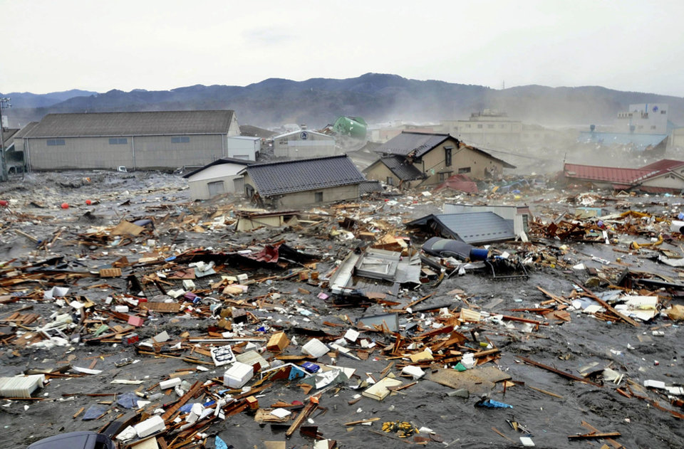 Photo - Houses, cars and other debris are washed away by tsunami tidal waves in Kesennuma in Miyagi Prefecture, northern Japan, after strong earthquakes hit the area Friday, March 11, 2011. (AP Photo/Keichi Nakane, The Yomiuri Shimbun)  JAPAN OUT, CREDIT MANDATORY ORG XMIT: TOK827
