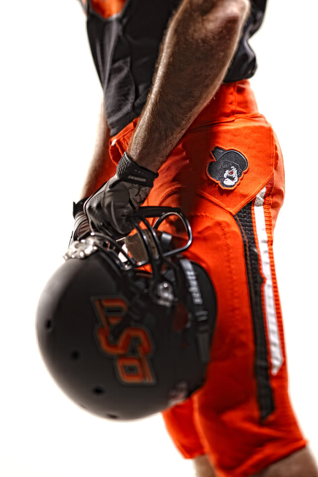 Photo - Oklahoma State's new football uniforms. Pictured here are the orange pants and the black helmet. PHOTO PROVIDED