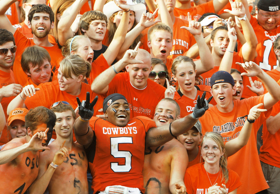 Photo - OSU's Keith Toston celebrated with fans after last week's win over Georgia. Now it's time for the Cowboys to let go of that win and take care of business against Houston today. Photo by Doug Hoke, The Oklahoman