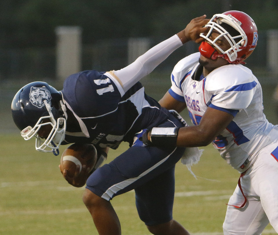 (ALTERNATE CROP) SS #11Marshawn Reid II plants a hand in the face of JM #10 Joseph Shells after an interception in the first quarter during the high school football game of John Marshall at Star Spencer, Thursday, September 26, 2013. Photo by Doug Hoke, The Oklahoman