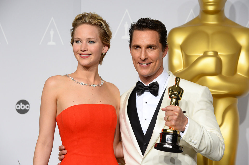 Photo - Matthew McConaughey, right, winner of the award for best actor for his role in the