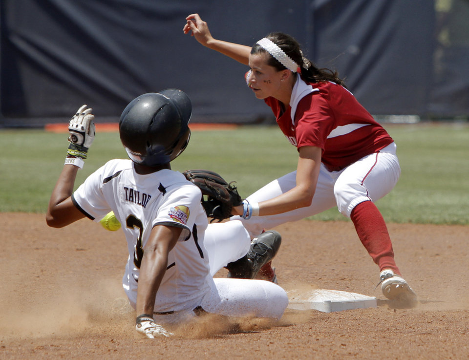 Photo - Oklahoma's Brianna Turang (2) waits for the ball as Missouri's Rhea Taylor (3) slides to second in the third inning of a Women's College World Series softball game between the University Oklahoma and Missouri at ASA Hall of Fame Stadium in Oklahoma City, Saturday, June 4, 2011.Taylor was ruled out on the play.  Missouri won, 4-1. Photo by Bryan Terry, The Oklahoman