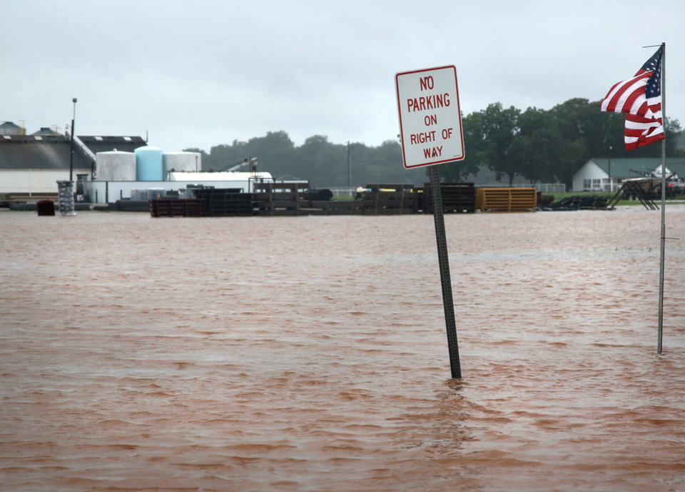 Photo - Rain from Hurricane Bill produced localized flooding in areas of Pottawatomie County on Thursday, June 18,  2015.   Hardesty Road and US 177. Tis photo shows a flooded field and parking lot west of US 177 in Shawnee. In background is Shawnee Feed Center. Photo by Jim Beckel, The Oklahoman.