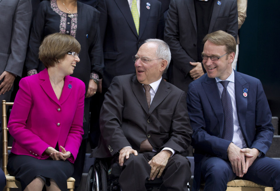 Photo - From left, Russian Monetary policy chief Ksenia Yudaeva,  German Finance Minister Wolfgang Schaeuble and Bundesbank President Jens Weidmann, speak during the G-20 finance ministers and central bank governors group photo on the sidelines of their meeting at World Bank Group-International Monetary Fund Spring Meetings in Washington, Friday, April 11, 2014. ( AP Photo/Jose Luis Magana)