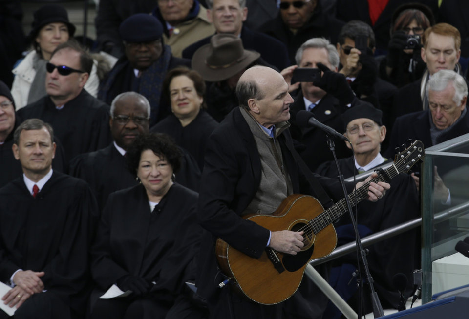 Photo - Singer James Taylor performs at the ceremonial swearing-in at the U.S. Capitol during the 57th Presidential Inauguration in Washington, Monday, Jan. 21, 2013. (AP Photo/Paul Sancya)