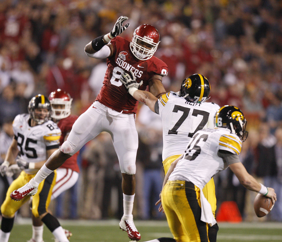 Oklahoma\'s Frank Alexander (84) tries to get past Iowa\'s Riley Reiff (77) as Iowa\'s James Vandenberg (16) scrambles during the Insight Bowl college football game between the University of Oklahoma (OU) Sooners and the Iowa Hawkeyes at Sun Devil Stadium in Tempe, Ariz., Friday, Dec. 30, 2011. Photo by Bryan Terry, The Oklahoman