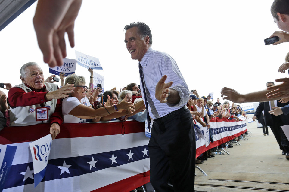 Republican presidential candidate, former Massachusetts Gov. Mitt Romney gestures as he greets supporters as he arrives at a Florida campaign rally at Orlando Sanford International Airport, in Sanford, Fla., Monday, Nov. 5, 2012. (AP Photo/Charles Dharapak)