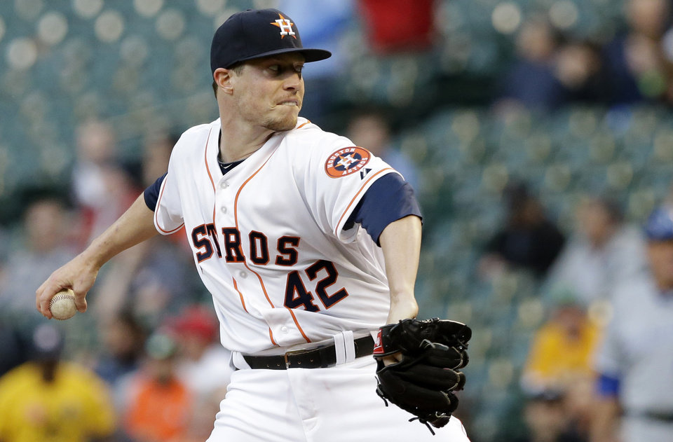 Photo - Houston Astros' Lucas Harrell winds up in the first inning of a baseball game against the Kansas City Royals on Tuesday, April 15, 2014, in Houston. All the players on both teams are wearing jerseys with No. 42 to honor Jackie Robinson. (AP Photo/Pat Sullivan)