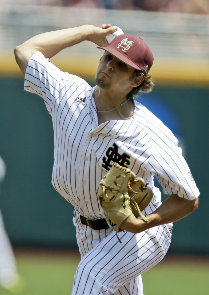 Photo - Mississippi State starting Kendall Graveman delivers against Oregon State in the first inning of an NCAA College World Series baseball game in Omaha, Neb., Friday, June 21, 2013. (AP Photo/Nati Harnik)