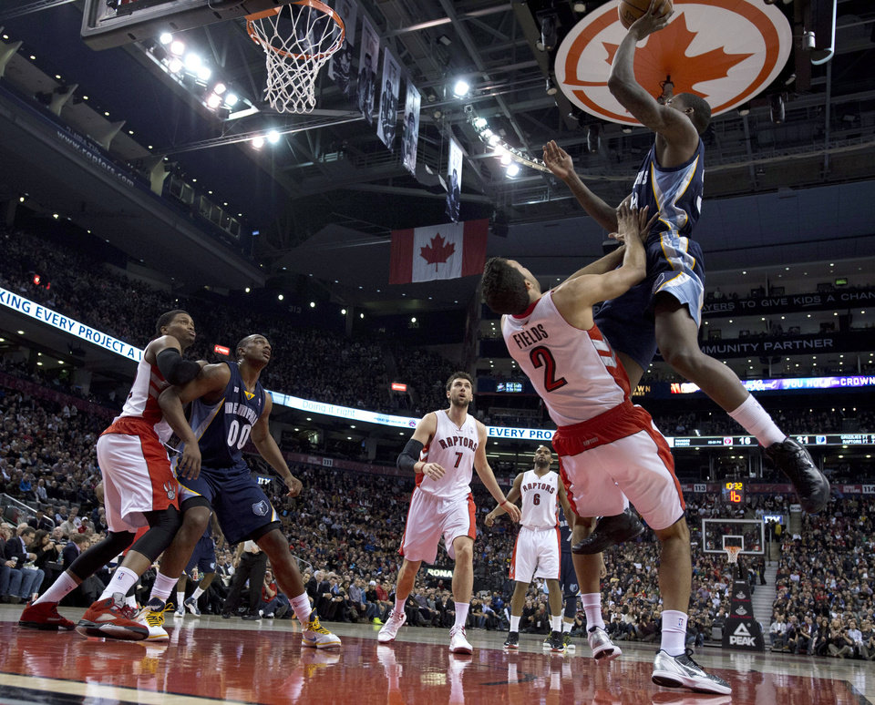 Memphis Grizzlies forward Ed Davis, right, picks up an offensive foul as he runs into Toronto Raptors forward Landry Fields (2) during the first half of an NBA basketball game in Toronto on Wednesday, Feb. 20, 2013. (AP Photo/The Canadian Press, Frank Gunn)