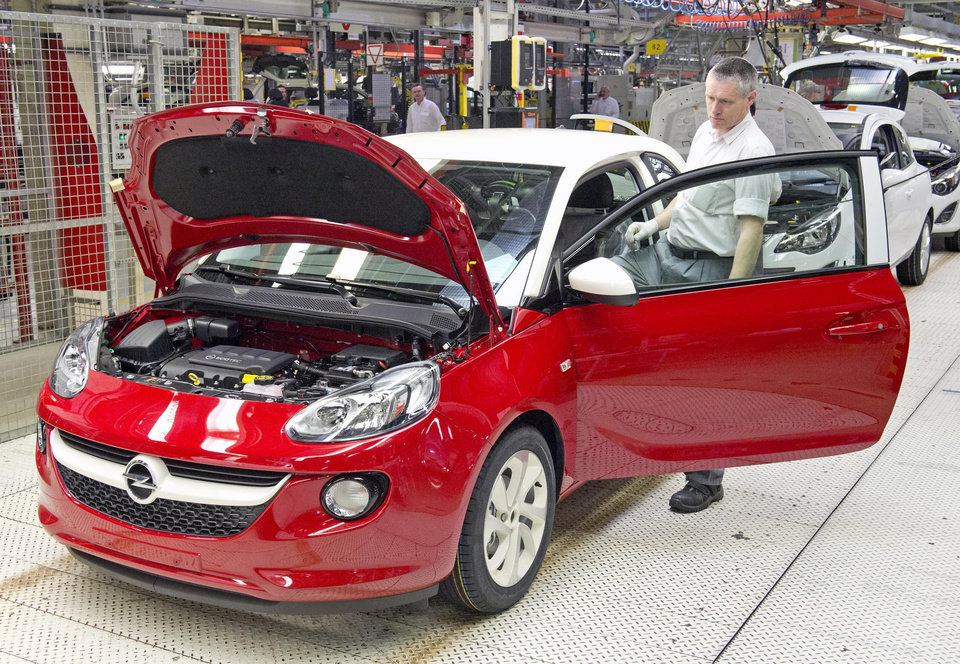 Photo - FILE - In this April 23, 2014 file photo, a worker completes an Opel Adam car at the German car company Opel Eisenach GmbH, owned by General Motors, in Eisenach, Germany. General Motors reports quarterly earnings on Thursday, April 24, 2014. (AP Photo/Jens Meyer, File)