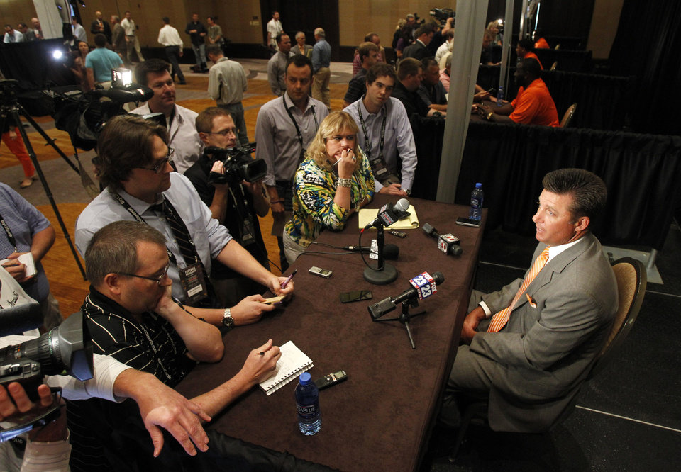Oklahoma State football coach Mike Gundy answers questions from the media during a breakout session at the Big 12 Conference Football Media Days Monday, July 22, 2013 in Dallas.  (AP Photo/Tim Sharp)