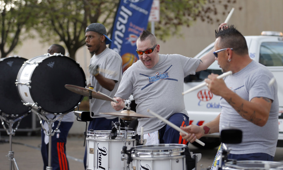 Photo - Thunder drummers entertain crowds before the Game 2 in the first round of the NBA playoffs between the Oklahoma City Thunder and the Memphis Grizzlies at Chesapeake Energy Arena in Oklahoma City, Monday, April 21, 2014. Photo by Sarah Phipps, The Oklahoman