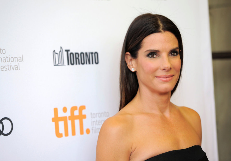 "Photo - FILE - In this Sept. 8, 2013 file photo, actress Sandra Bullock arrives at the premiere of ""Gravity"" on day 4 of the Toronto International Film Festival at The Princess of Wales Theatre, in Toronto.  Bullock says making the lost-in-space movie ""Gravity"" with director Alfonso Cuaron was her ""best life decision"" ever. The film releases in US theatres Friday, Oct. 4, 2013. (Photo by Chris Pizzello/Invision/AP, File)"