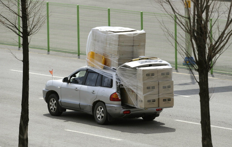 Photo - A South Korean vehicle carrying boxes, returning from the North Korean city of Kaesong arrives at the customs, immigration and quarantine office near the border village of Panmunjom, which has separated the two Koreas since the Korean War, in Paju, north of Seoul, South Korea, Tuesday, April 9, 2013. North Korean workers didn't show up for work at the Kaesong industrial complex, a jointly run factory with South Korea on Tuesday, a day after Pyongyang suspended operations at the last remaining major economic link between rivals locked in an increasingly hostile relationship. (AP Photo/Lee Jin-man)