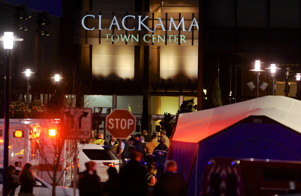 Photo - Police and medics work the scene of a multiple shooting at Clackamas Town Center Mall in Clackamas, Ore., Tuesday Dec. 11, 2012. A gunman is dead after opening fire in the Portland, Ore., area shopping mall Tuesday, killing two people and wounding another, sheriff's deputies said. (AP Photo/Greg Wahl-Stephens)