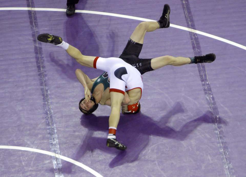 Photo - Muskogee's Lukas Etchison wrestles Union's Josh Walker in the 120-pound match during the state wrestling championships at the State Fair Arena in Oklahoma City, Saturday, Feb. 25, 2012. Photo by Sarah Phipps, The Oklahoman
