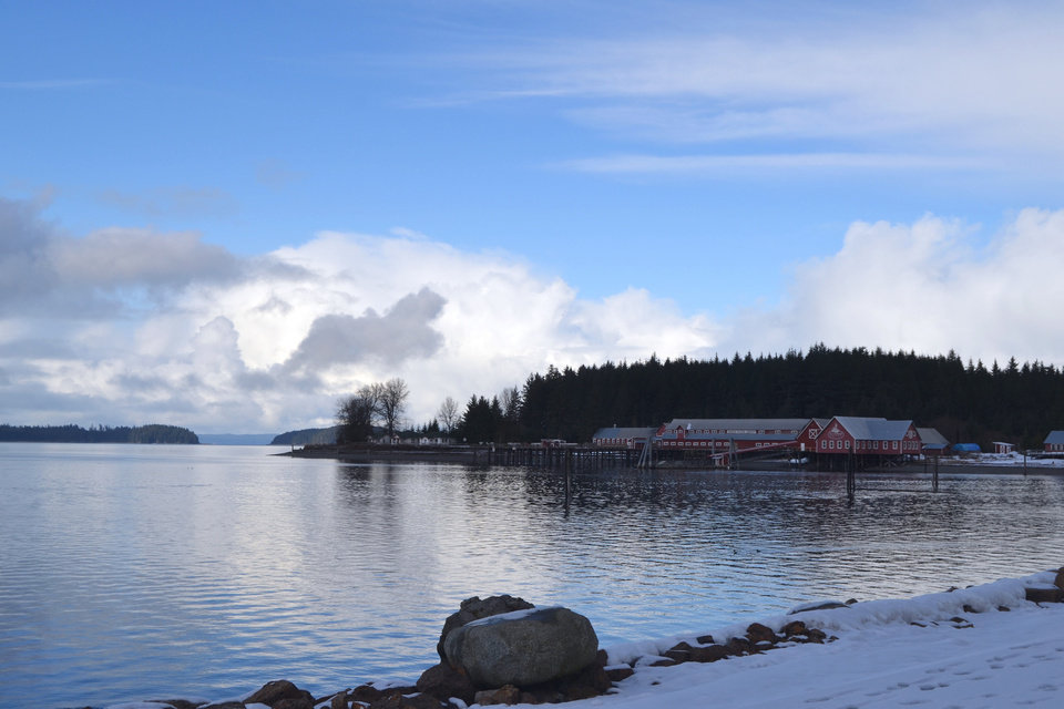 Photo - The Icy Strait Point visitor complex is seen on the road from Hoonah, Alaska on March 19, 2014. The facility, 1.5 miles from the village of 750 people, is built around the restored Hoonah Packing Company complex and is owned by Huna Totem Corporation. Cruise ships have been visiting ISP since 2004, but Hoonah residents have been divided by a plan to build a new multimillion-dollar cruise ship dock. (AP Photo/Mary Catharine Martin, Capital City Weekly via The Juneau Empire)