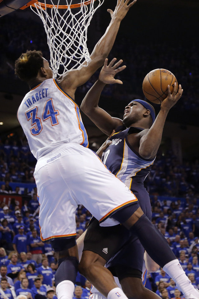 Photo - Memphis' Zach Randolph (50) shoots past Oklahoma City's Hasheem Thabeet (34) during the second round NBA playoff basketball game between the Oklahoma City Thunder and the Memphis Grizzlies at Chesapeake Energy Arena in Oklahoma City, Sunday, May 5, 2013. Photo by Chris Landsberger, The Oklahoman