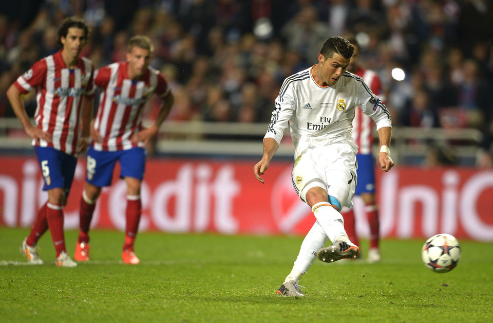 Photo - Real's Cristiano Ronaldo scores his side's 4th goal, during the Champions League final soccer match between Atletico Madrid and Real Madrid in Lisbon, Portugal, Saturday, May 24, 2014. (AP Photo/Manu Fernandez)