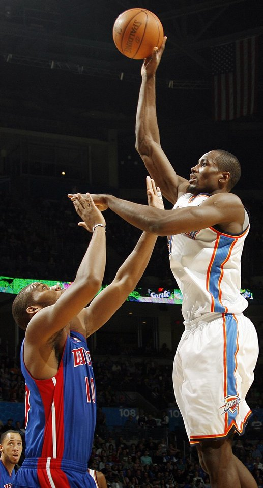 Photo - Oklahoma City's Serge Ibaka (9) takes a shot over Greg Monroe (10) of Detroit during an NBA basketball game between the Oklahoma  City Thunder and the Detroit Pistons at the OKC Arena in Oklahoma City, Friday, March 11, 2011. Photo by Nate Billings, The Oklahoman