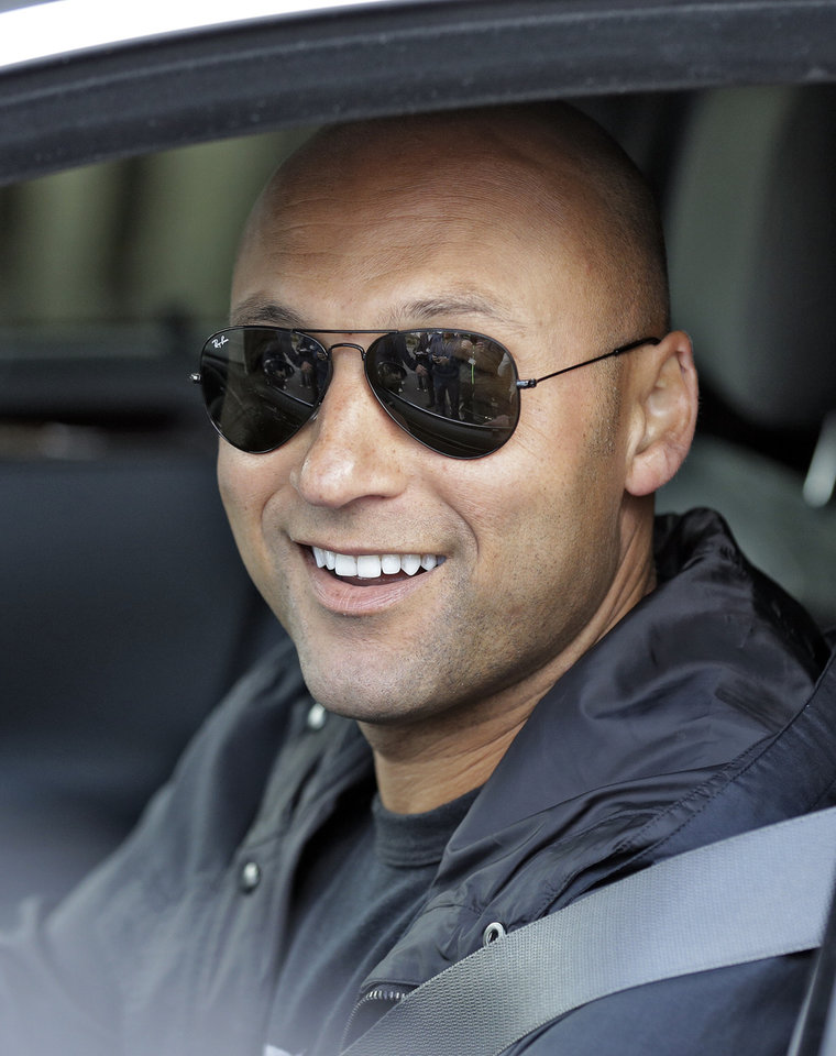 Photo - New York Yankees shortstop Derek Jeter smiles as he leaves after practicing at the baseball team's minor league facility Thursday, Feb. 13, 2014, in Tampa, Fla. Jeter announced that he will be retiring after the 2014 season. (AP Photo/Chris O'Meara)