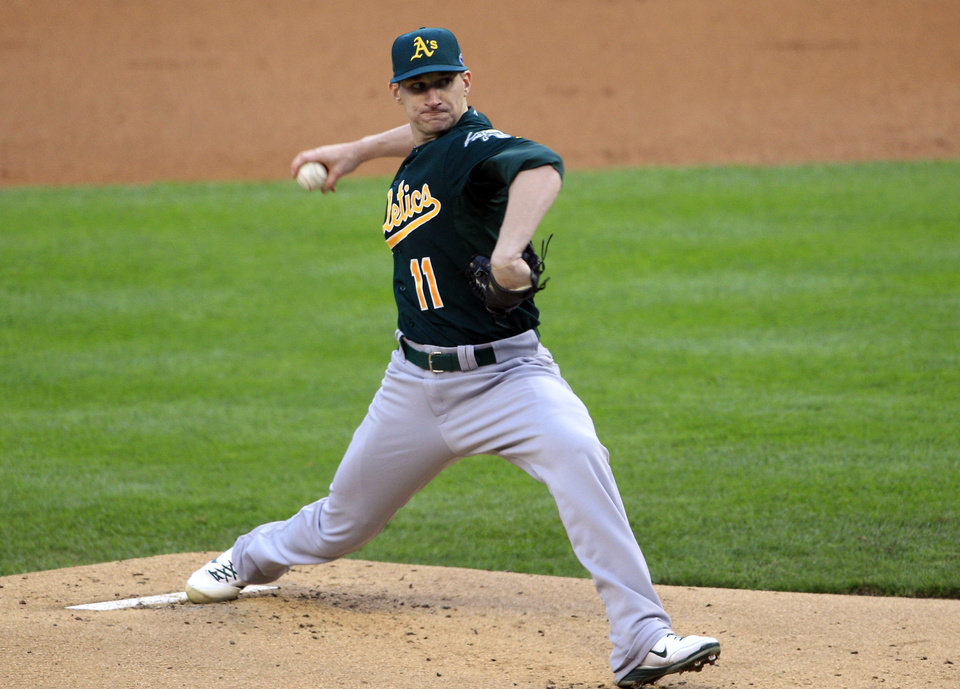 Oakland Athletics starting pitcher Jarrod Parker (11) throws during the first inning of Game 1 of the American League division baseball series against the Detroit Tigers, Saturday, Oct. 6, 2012, in Detroit. (AP Photo/Carlos Osorio)