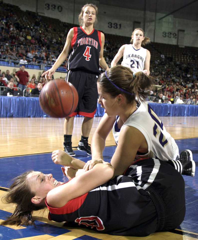 Photo - Frontier's Tiffany Young and Okarche's Morgan Vogt fight for a loose ball duringClass A girls state championship high school basketball game between Okarche and Frontier at the State Fair Arena in Oklahoma City,  Saturday, March 3, 2012. Photo by Sarah Phipps, The Oklahoman