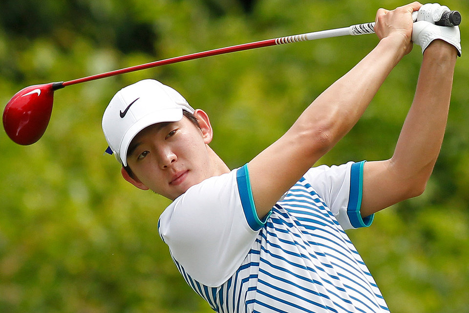 Photo - Seung-yul Noh, of South Korea, tees off on the second hole during the third round of the PGA Zurich Classic golf tournament at TPC Louisiana in Avondale, La., Saturday, April 26, 2014. (AP Photo/Jonathan Bachman)