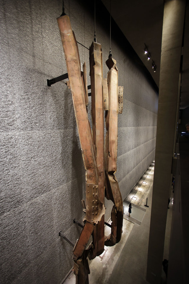 Photo - A section of steel facade, from floors 96-99 of the north tower of the World Trade Center, is displayed at the National Sept. 11 Memorial Museum, Wednesday, May 14, 2014, in New York. The museum is a monument to how the Sept. 11 terror attacks shaped history, from its heart-wrenching artifacts to the underground space that houses them amid the remnants of the fallen twin towers' foundations. It also reflects the complexity of crafting a public understanding of the terrorist attacks and reconceiving ground zero.  (AP Photo)