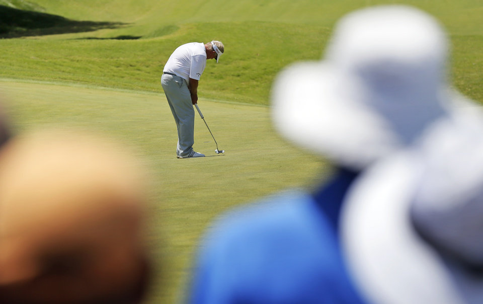 Photo - Colin Montgomerie putts on No. 7 during the final round of the U.S. Senior Open golf tournament at Oak Tree National in Edmond, Okla., Sunday, July 13, 2014. Photo by Nate Billings, The Oklahoman