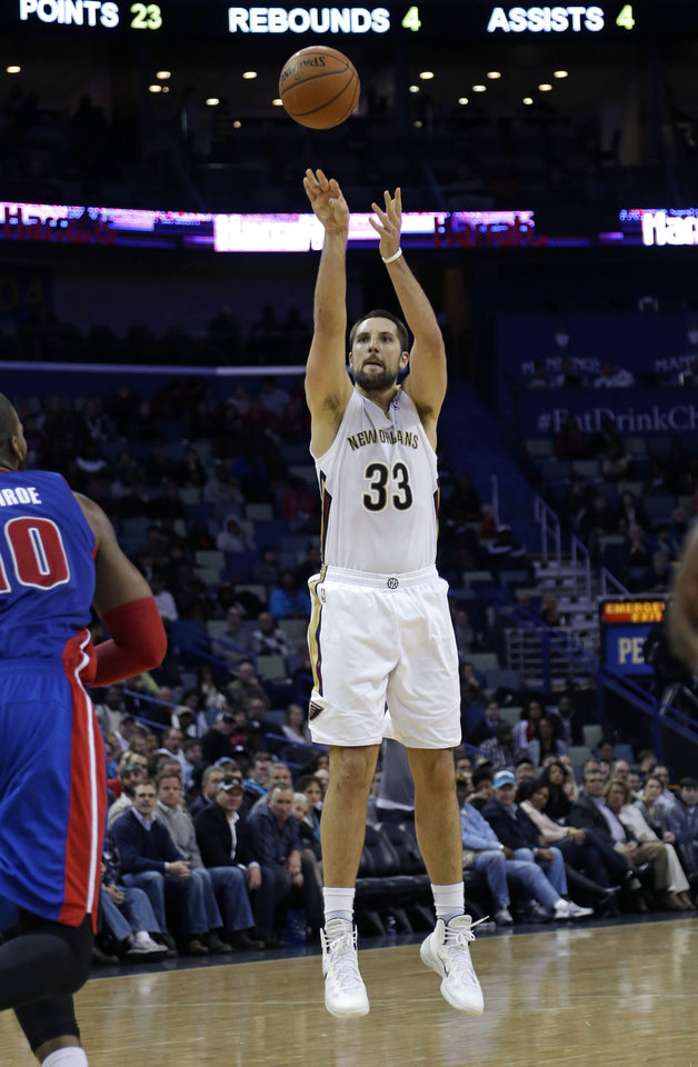 New Orleans Pelicans power forward Ryan Anderson (33) shoots a three-point attempt in front of Detroit Pistons power forward Greg Monroe (10) in the second half of an NBA basketball game in New Orleans, Wednesday, Dec. 11, 2013. The Pelicans won in overtime 106-100. (AP Photo/Gerald Herbert)