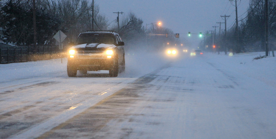 Photo - Traffic in the blowing on NW 63 Street west of Meridian just before sunrise Wednesday, Feb. 9, 2011. Photo by Paul B. Southerland, The Oklahoman
