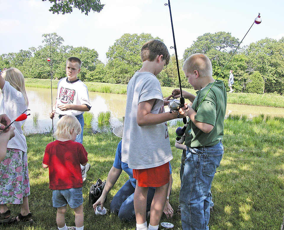 Young anglers try their luck at fishing at Tenkiller State Park. PHOTO PROVIDED.