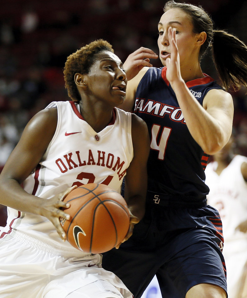 Photo - Oklahoma's Sharane Campbell (24) takes the ball to the hoop against Samford's Lydia McGee (4) during a women's college basketball game between the University of Oklahoma Sooners and the Samford Bulldogs at Lloyd Noble Center in Norman, Okla., Sunday, Dec. 29, 2013. OU won, 66-35. Photo by Nate Billings, The Oklahoman