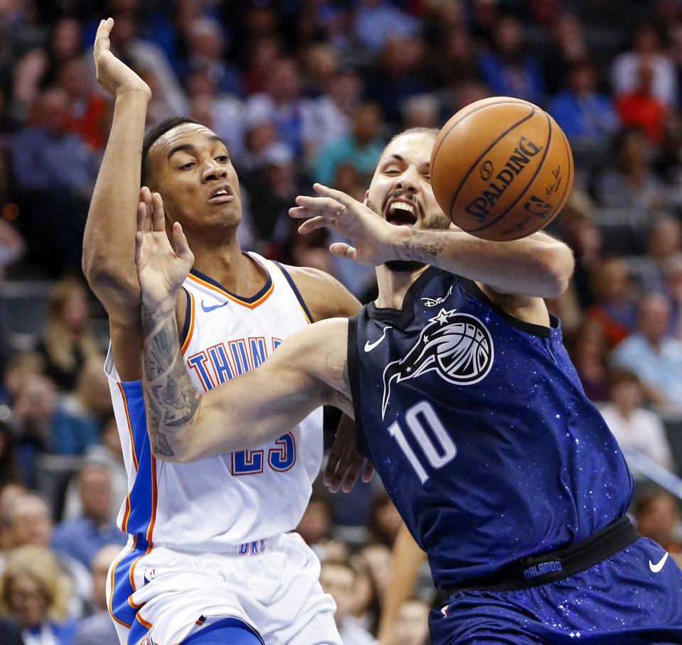 Photo - Orlando's Evan Fournier (10) loses the ball next to Oklahoma City's Terrance Ferguson (23) during an NBA basketball game between the Oklahoma City Thunder and the Orlando Magic at Chesapeake Energy Arena in Oklahoma City, Monday, Feb. 26, 2018. Oklahoma City won 112-105. Photo by Nate Billings, The Oklahoman