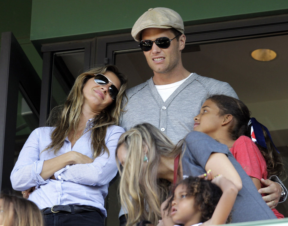 Photo -   New England Patriots quarterback Tom Brady and his wife, Giselle, left, stand in a box during a baseball game between the Boston Red Sox and the New York Yankees at Fenway Park in Boston, Friday, April 20, 2012. (AP Photo/Elise Amendola)