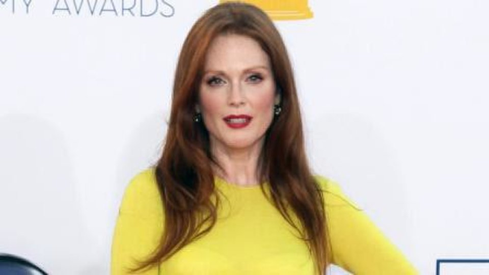 Actress Julianne Moore wears a dark cherry shade of red lipstick. AP Photo. <strong></strong>