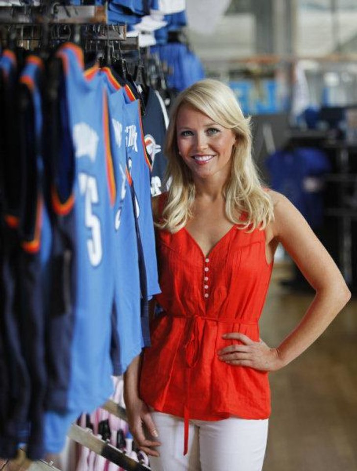 Photo - Thunder Girl Kelsey Qullian poses for a photo in the Thunder Shop in Oklahoma City. Quillian graduated from the University of Oklahoma School of Law this year.  Steve Gooch - THE OKLAHOMAN