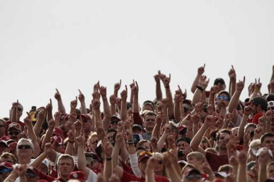 Photo - Oklahoma fans cheer during the Red River Rivalry college football game between the University of Oklahoma and the University of Texas  at the Cotton Bowl in Dallas, Saturday, Oct. 13, 2012. Oklahoma won 63-21. Photo by Bryan Terry