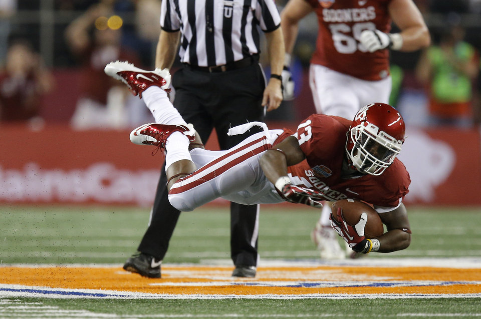 Photo - Oklahoma's Durron Neal (13) leaps during the Cotton Bowl college football game between the University of Oklahoma (OU)and Texas A&M University at Cowboys Stadium in Arlington, Texas, Friday, Jan. 4, 2013. Oklahoma lost 41-13. Photo by Bryan Terry, The Oklahoman
