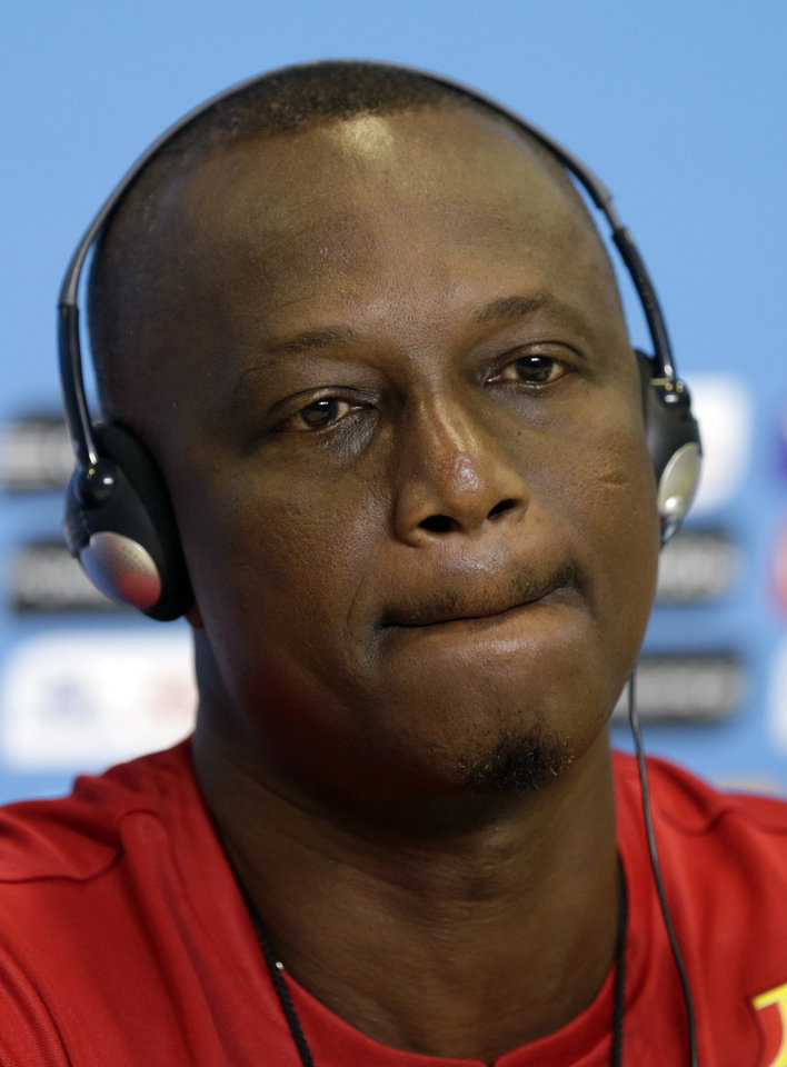 Photo - Ghana's head coach James Appiah attends a news conference before an official training session the day before the group G World Cup soccer match between Ghana and the United States at the Arena das Dunas in Natal, Brazil, Sunday, June 15, 2014.  (AP Photo/Dolores Ochoa)