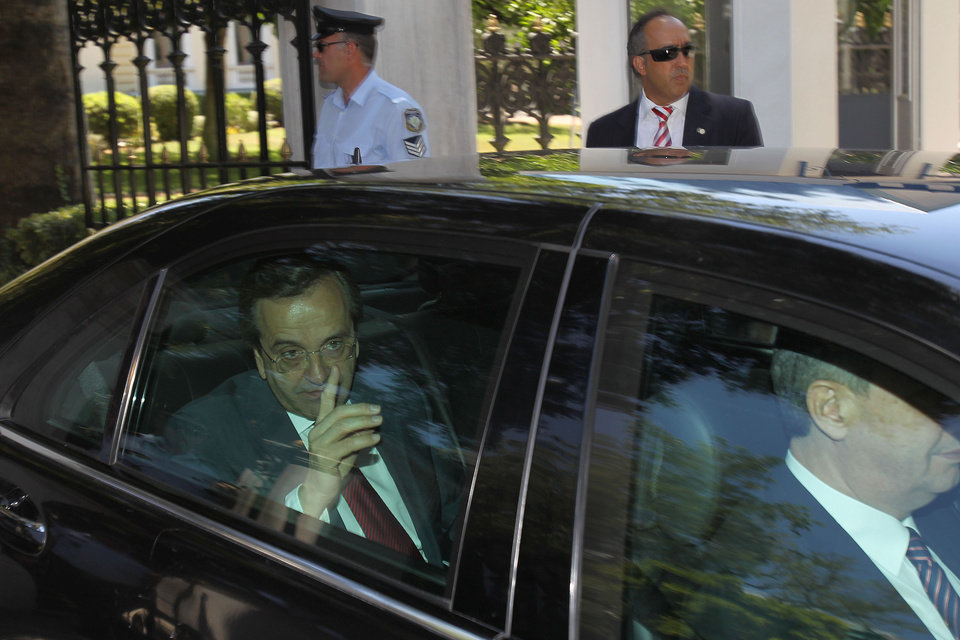 Photo -   Greece's conservative election victor Antonis Samaras leaves the presidential palace after meeting Greek President Karolos Papoulias in Athens, Monday, June 18 2012. Europe looked on with wary relief Monday as Samaras received a mandate to launch coalition talks after coming first in national elections that follow weeks of uncertainty over the debt-crippled country's future in the continent's joint currency. (AP Photo/Petros Karadjias)