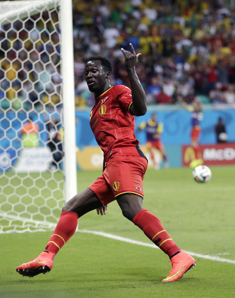 Photo - Belgium's Romelu Lukaku celebrates after scoring his side's second goal during the World Cup round of 16 soccer match between Belgium and the USA at the Arena Fonte Nova in Salvador, Brazil, Tuesday, July 1, 2014.   (AP Photo/Julio Cortez)