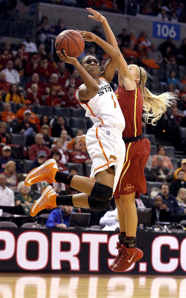 Photo - Oklahoma State's Brittany Atkins (1) shoots a lay up as Iowa State's Jadda Buckley (11) defends during the Women's Big 12 basketball tournament at  Chesapeake Energy Arena  in Oklahoma City, Okla., Saturday, March 8, 2014. Photo by Sarah Phipps, The Oklahoman