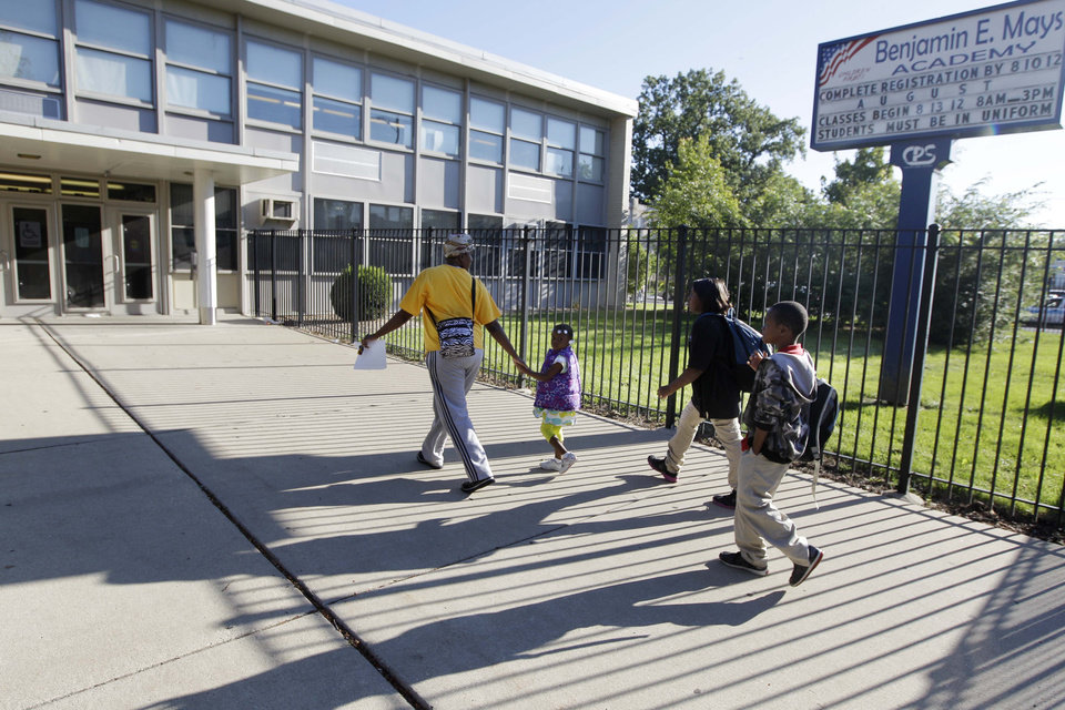 Photo -   Parents drop their children off at Benjamin E. Mays Academy, one of the few schools open for a half day during the first day of a Chicago teachers strike, Monday, Sept. 10, 2012, in Chicago. Thousands of teachers walked off the job in the nation's third-largest school district for the first time in 25 years after union leaders announced they were far from resolving a contract dispute with school district officials. (AP Photo/M. Spencer Green)