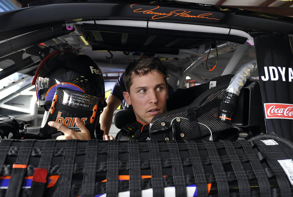 Photo - NASCAR Sprint Cup series driver Denny Hamlin sits in his car as he prepares for practice at the Talladega Superspeedway in Talladega, Ala., Friday, May 3, 2013. Hamlin was back in the race car for the first time since suffering a compression fracture of a vertebra in his lower back in a last-lap crash at California on March 24.  (AP Photo/Rainier Ehrhardt)
